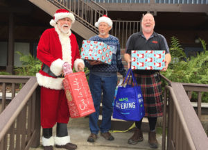 The Center's Adopt a Family Program Santa and his Elves