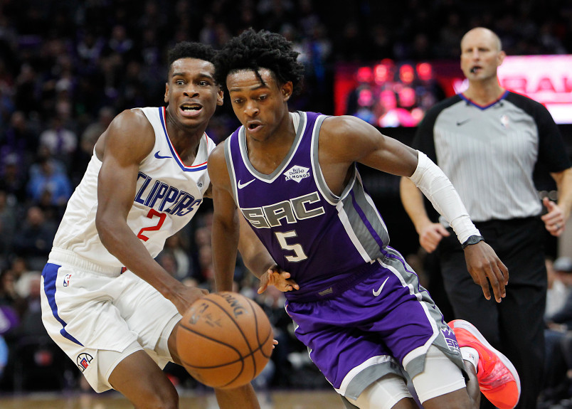 Sacramento Kings guard De'Aaron Fox (5) drives around Los Angeles Clippers guard Shai Gilgeous-Alexander (2) during the second half of an NBA basketball game in Sacramento, Calif., Thursday, Nov. 29, 2018. The Clippers won 133-121. (AP Photo/Steve Yeater)
